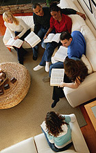 A group read and discuss bibles together at one of their houses